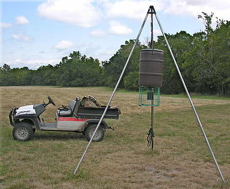 Tripod feeder with hoist assembly
