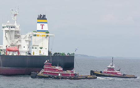 Tugs escorting a tanker ship into Casco Bay