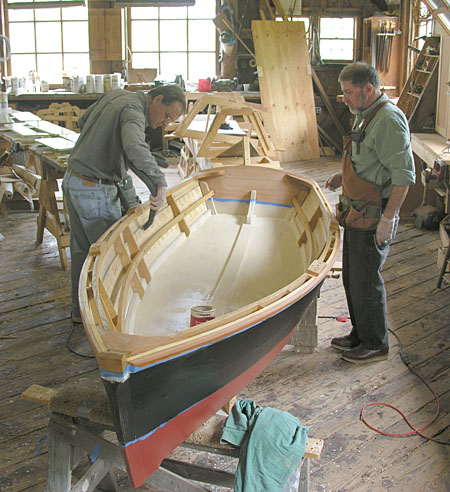 Craftsmen working on a small boat