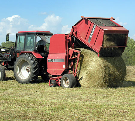 Discharging the finished bale of hay