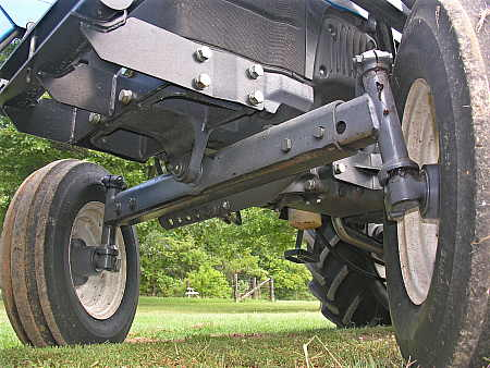 No dampening suspension underneath the tractor