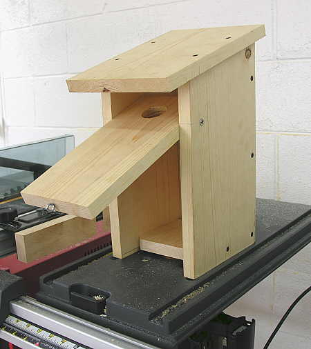 Nesting box (seen with the front panel open)